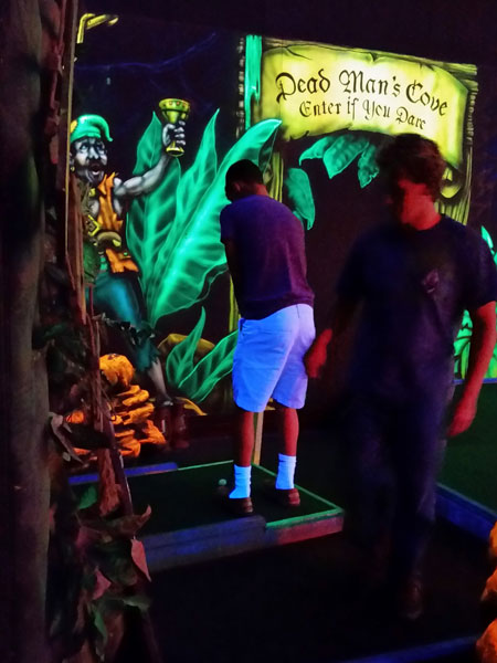 Seniors Thane Henderson and Derek Wright play mini golf at the Columbia mall. Wright won the match.