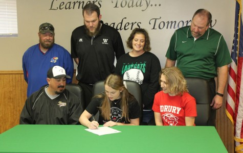 WHS senior Kylie McRoberts signed to play softball for the NCAA Division 2 Drury Panthers on Thursday, March 10. Picutred are McRoberts, along with her parents Eric and Teresa Flores, McRoberts' competitive team coach Steve Sutter, and WHS coaches Dennis Larsen, Kensie Daleske and Steve Larsen.
