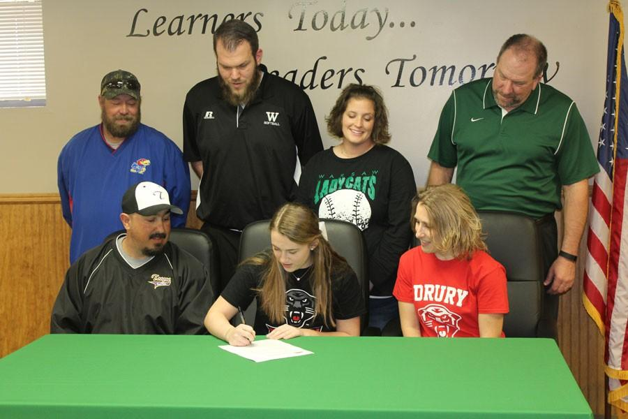WHS+senior+Kylie+McRoberts+signed+to+play+softball+for+the+NCAA+Division+2+Drury+Panthers+on+Thursday%2C+March+10.+Picutred+are+McRoberts%2C+along+with+her+parents+Eric+and+Teresa+Flores%2C+McRoberts%27+competitive+team+coach+Steve+Sutter%2C+and+WHS+coaches+Dennis+Larsen%2C+Kensie+Daleske+and+Steve+Larsen.
