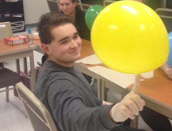 Senior Andrew Savage  entertains himself with a balloon in his Health Occupations class at CTC. The class practices shaving facial hair with the balloons.