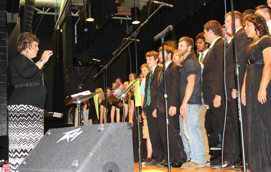 Vocal music director Charlene Million directs WHS vocalists and alumni in