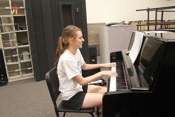 Senior Claudia Schmitz practices her solo for state in Jazz Band.