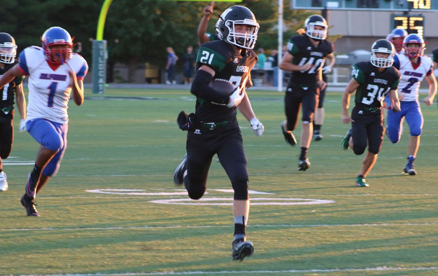 Senior Trenton Simons runs for the end zone during the Homecoming game against the California Pintos. Simons scored the only touchdown for the Wildcats.