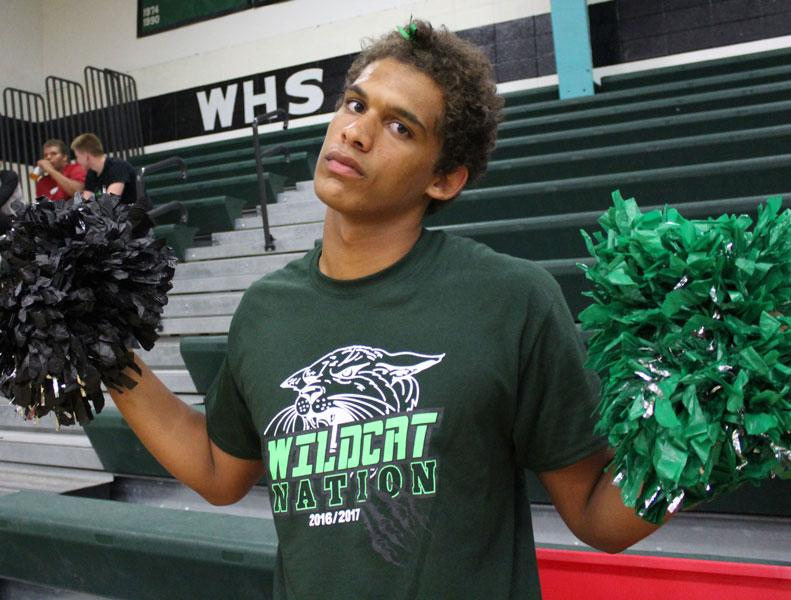 Senior+Wesley+Carr+prepares+to+cheer+on+the+volleyball+team+in+their+game+against+Stover.+Carr+helped+distribute+the+pom-poms+to+the+pep+club.
