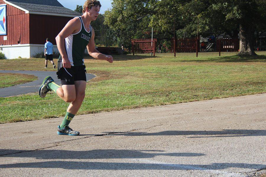 Sophomore Maleek Porter runs the course in Stover on Oct. 5th. Porter is one of the top boys varsity runners on the team.