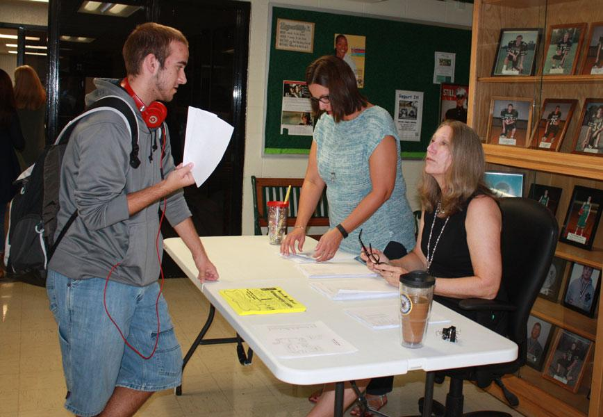 Sophomore+Eric+Meldrum+talks+to+counselor+Laura+Cooke+about+schedules.+Every+student+was+offered+a+copy+of+their+schedule+when+they+walked+into+the+school.