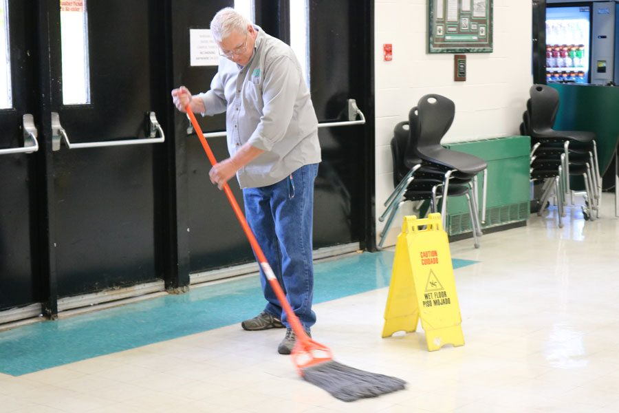Custodian+Alan+Khin+mops+the+cafeteria+floor+after+the+last+lunch+shift.+Khin+also+sets+up+the+cafeteria%2C+cleans+it+between+shifts%2C+and+takes+it+all+down+every+day.+Its+not+that+hard%2C+Khin+said%2C+Just+gotta+keep+up+on+things+and+stay+on+top+of+it.