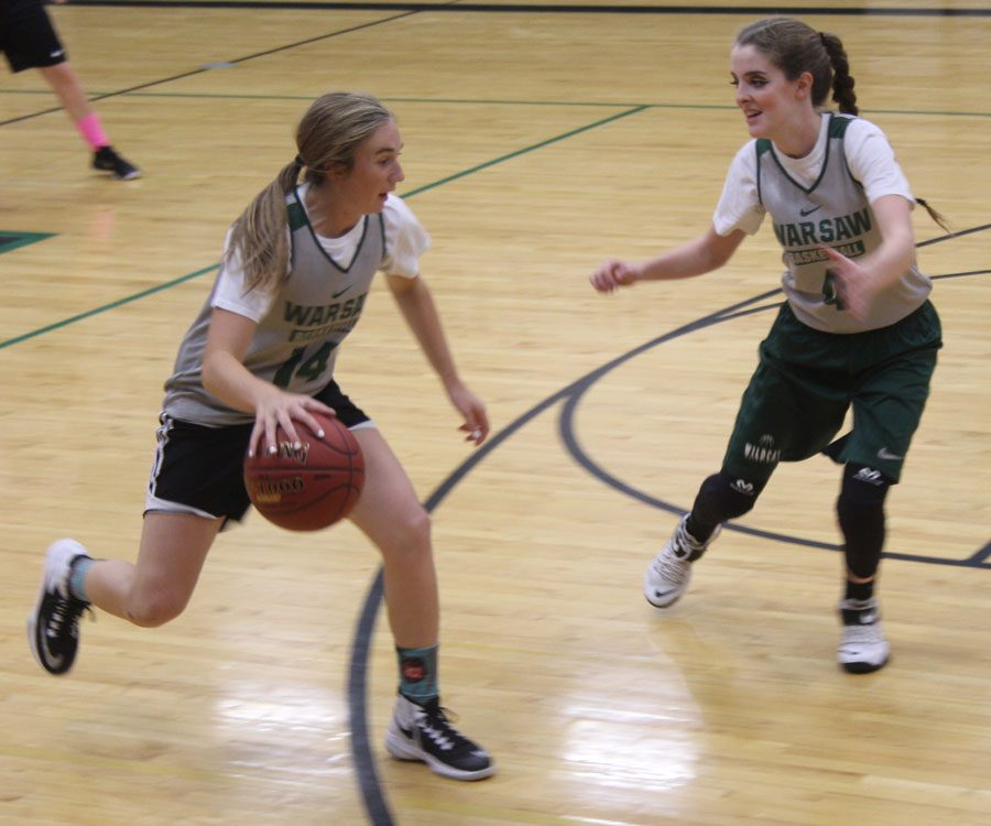 Freshman guard Aubrie McRoberts dribbles the ball down the court in practice as junior guard Hannah Chapman guards. The overall goal for the team is to improve the record and improve each other.