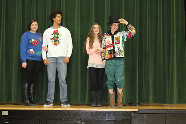 Below: Seniors Kaci Cooner, Wesley Carr, Hannah Chapman and Noah Long face off in the 2015 Mr. Christmas Prince contest at the holiday assembly. Carr, the 2015 prince winner, said he will participate again this year.