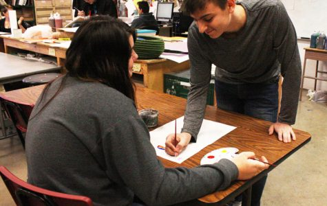 Senior Nathan Stutes helps sophomore Deanna Garoutte with her painting project. Stutes helps anyone in anyway he can.