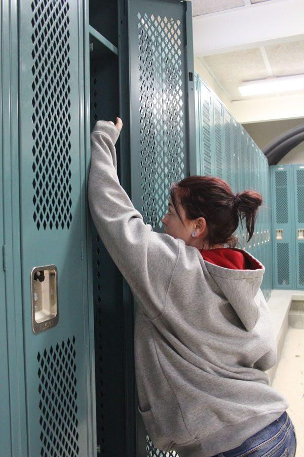 Junior+Madi+Rozzel+reaches+into+one+of+the+new+lockers.+The+new+lockers+were+installed+over+Christmas+break.+Photo+by+Destiny+Lee.