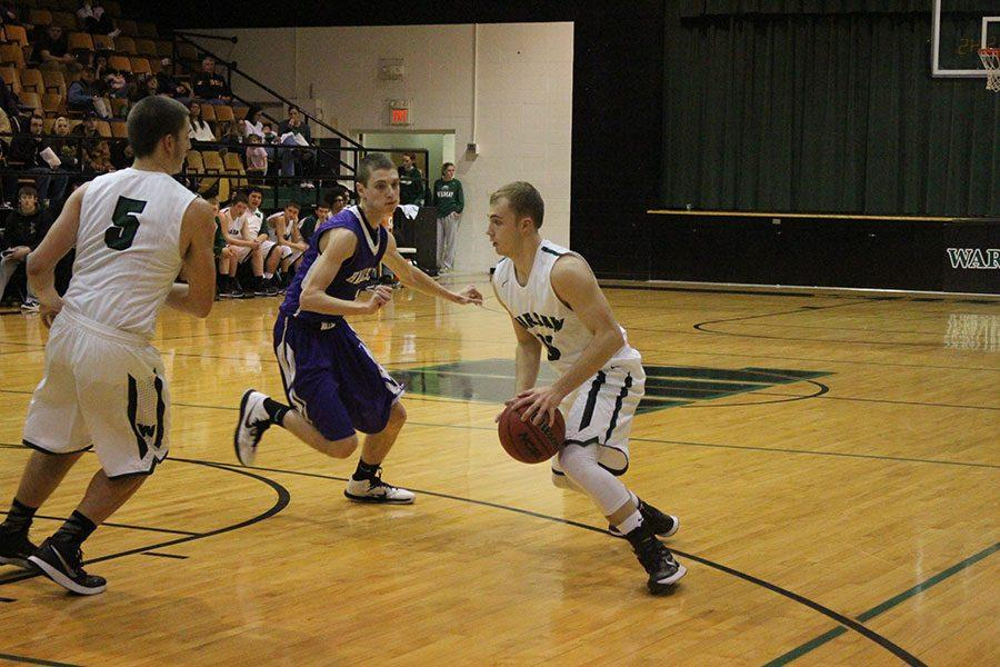 2015 graduate Randall Sherman prepares to make a play during a game against Hallsville. Sherman made school history during his senior after shooting his 2,000th point .