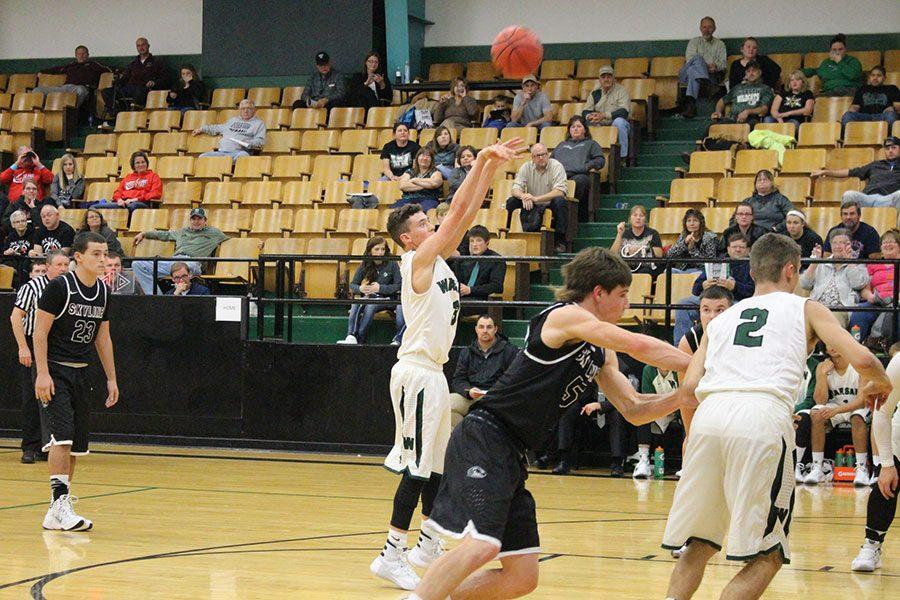 2016 graduate Thane Henderson shoots at the free throw line. Thane's father, Thad Henderson, started the tradition of Warsaw Basketball for his family.