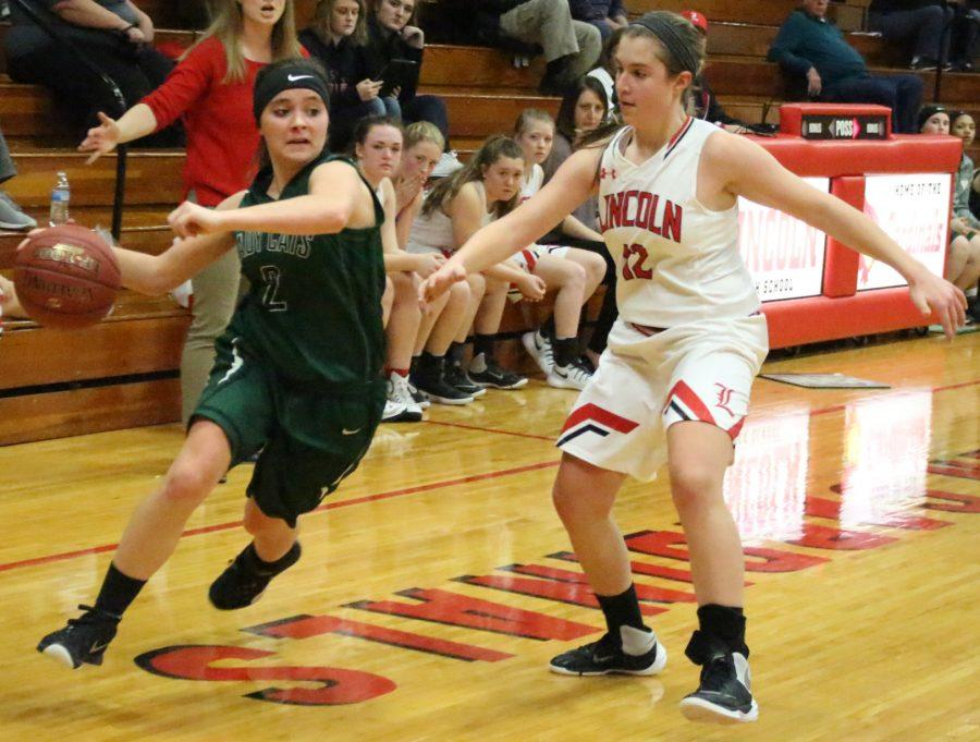 Senior Cierra Sawyers dribbles the ball in a game against Lincoln. The Lady Cats were defeated 67-59 by the Lady Cardinals.