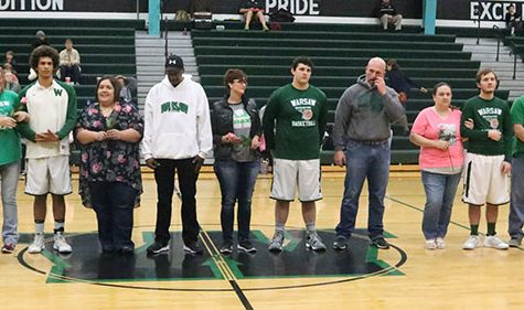 Senior players stand with their parents during senior night. Senior night was held on Tuesday, Feb. 14.