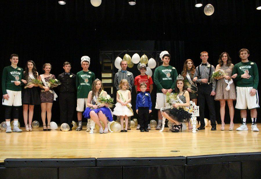 The Courtwarming court lines up for a picture after coronation. They include (back row): Prince and princess candidates juniors Ryan Sprouse, Kyra Kleihauer, Briar Strunk, Cody Wilson, Tyler Simons, senior Noah Long, 2016 queen Kylie McRoberts, king and queen candidates seniors Austin Gardner, Sadie Friend, Trenton Simons, Bailey Sharp, and Anthony Beuke, (front row): Junior Ashton Adams, flower girl Addison Young, crown bear Joey Deckard, and senior Ashlee Kuykendall. Juniors Tyler Simons and Ashton Adams were crowned prince and princess and seniors Austin Gardner and Ashlee Kuykendall were crowned king and queen.