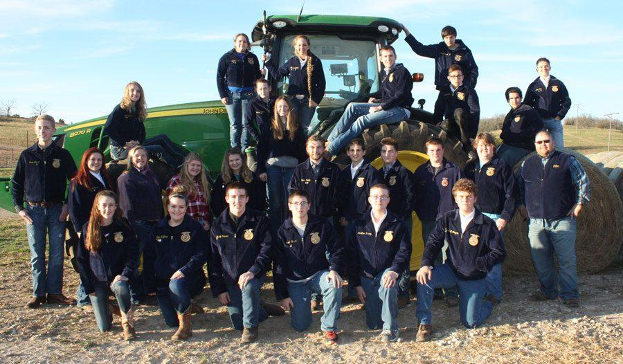 2016-17 WHS FFA members.  First row: Allison Pool, Erika Huffman, Austin Rosser, Jacob Weiser, Jonathan Harvey, Connor McLaughlin. Second Row: Jesse Johnson, Brandi Hubert, Megan Mantonya, Savannah Neth, Morgan McGann, Hunter Bagley, Lerran Yoder, Aidan Comer, Zach Nelson, King Archer, Advisor Mr. Stan Adler. On tractor: Emily Engebretsen, Alexis Smith, Heather Weaver, Kaitlyn Hawley, Ashlyn Yoder, Rayne Faulconer, Nelson Johnson, Gabe Blen, Dustin Coffey, Alex Long.