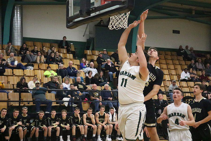 Senior power forward/center Austin Gardner goes up for a shot against Versailles. Garder hopes to see a victory against Versailles.