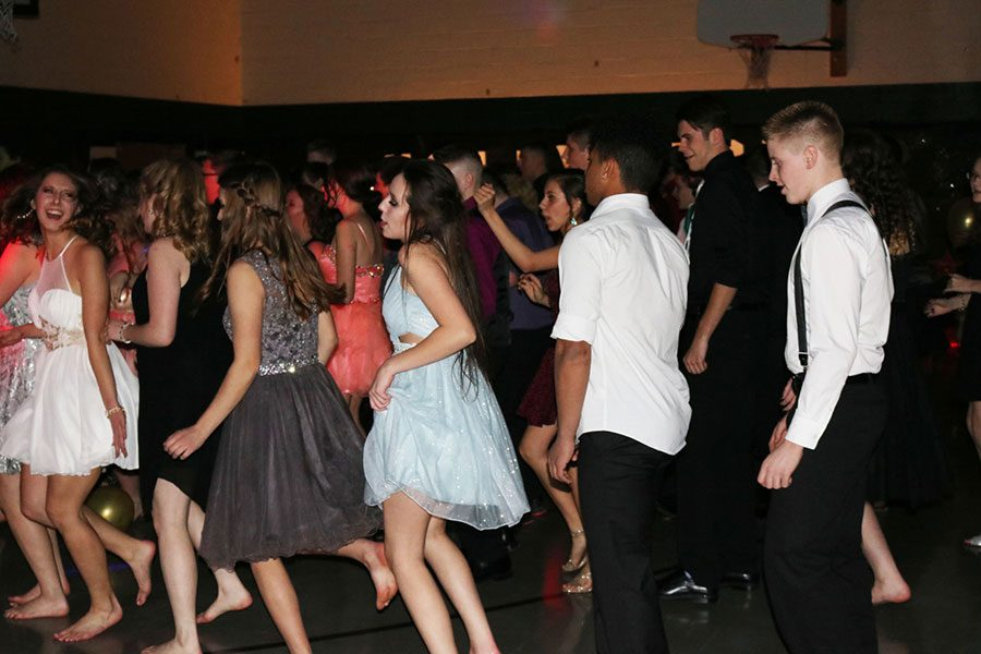 Sophomores Rylee Pals, Kieon Davis and Kolby Estes dance at the Echoes Ball. The cafeteria was decorated with a Hollywood movie theme.