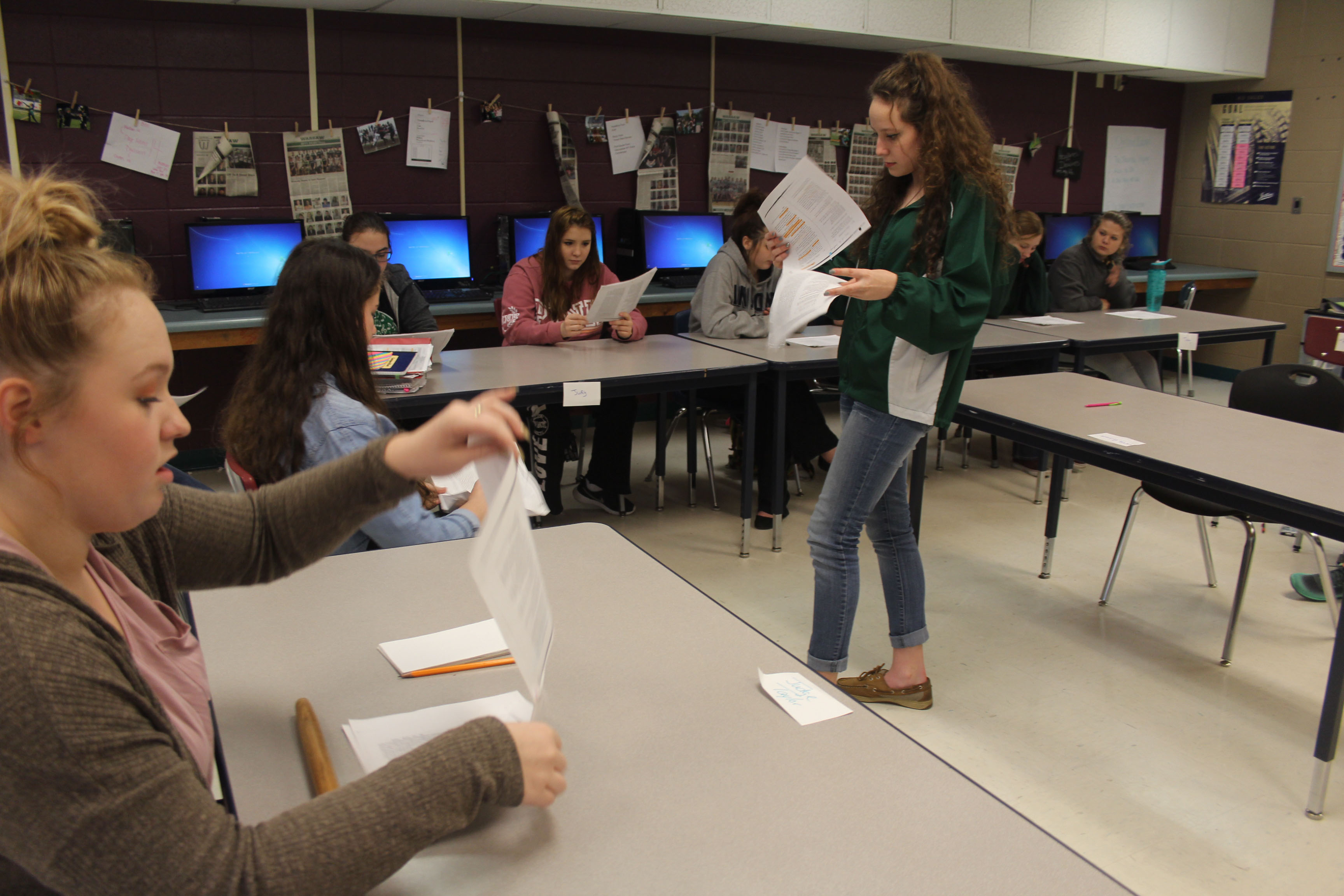 Sophomore Rylee Pals, Kamryn Yach, and Taylor Bunch participate in the script reading of To Kill a Mockingbird. All English 2 classes spent a week reenacting the trial scene from the book.