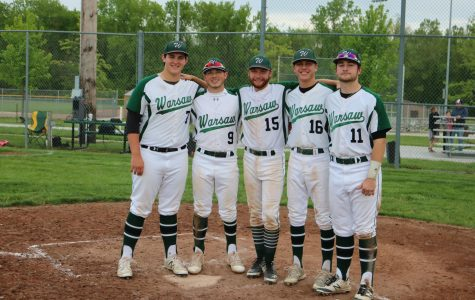 Seniors Austin Gardner, Corey Callahan, Hunter Bagley, Cade Chiles, and Will Bunch stand together at the plate during senior night. The group has been noticed for showing their friendship on and off the field.