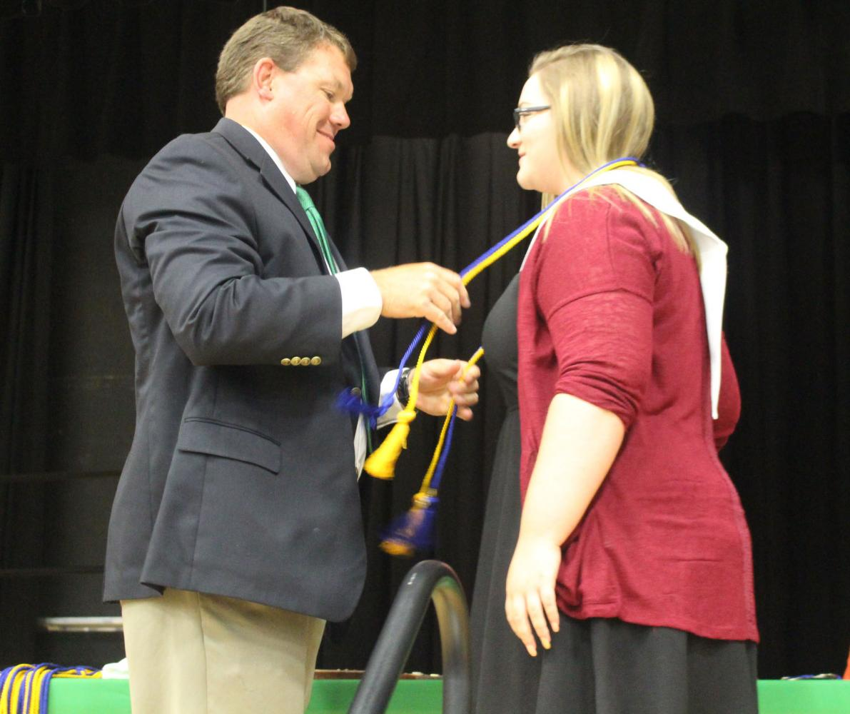 Senior Maddie Freeman is presented her National Honor Society cords at senior awards on Sunday, May 14. Freeman removes all noise and distraction when going to study, even though she naturally has an easy time with academics.