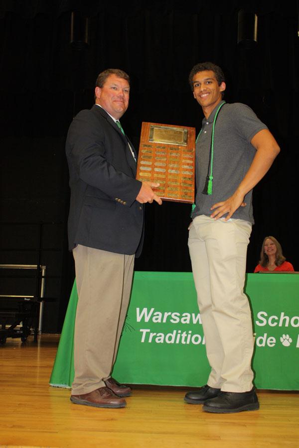 Senior Wesley Carr receives the Parsons Award from principal Randy Luebbert.