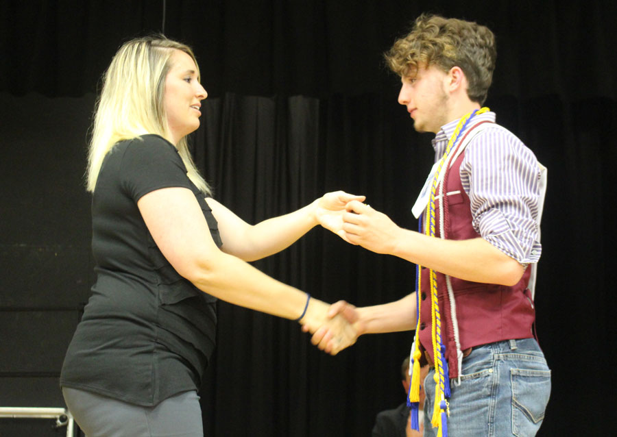 Student Council President Noah Long receives a medal and student council cord.