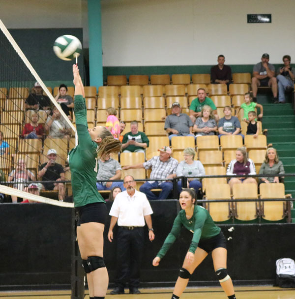Junior, middle hitter, Madie Gardner and Sophomore, outside hitter, Ally Wenberg prepares to block the ball from opposing team Blair Oaks.  Warsaw lost to Blair Oaks in two sets.