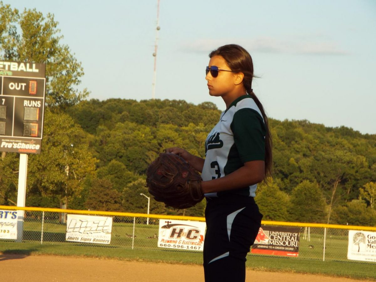 Junior Kinsten Cunningham waits for the play at first base in the jv game.