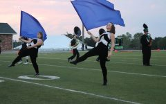 Color guard enhances visual performance of band
