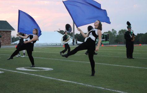 Color guard enhances visual performance of band