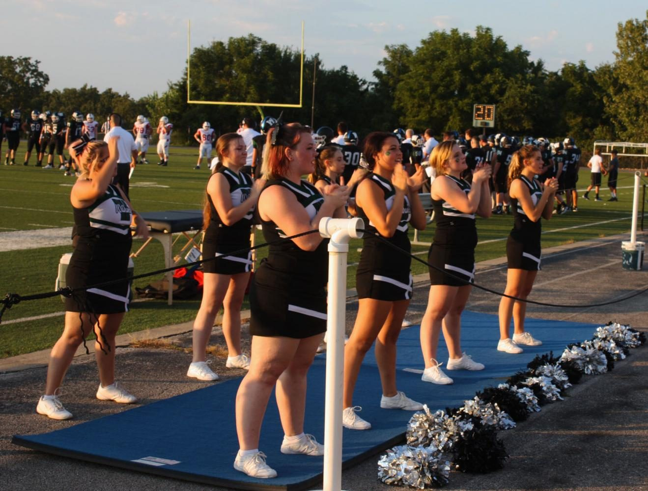 The+cheerleaders+rally+the+crowd+for+the+win+against+Clinton.+The+final+score+was+14-12.
