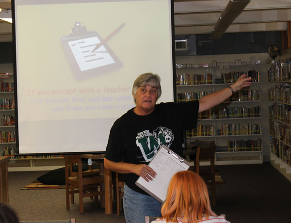Librarian Lori Allen speaks to the sixth graders about the rules of the library. Allen told the sixth graders where to check out books, how to use bookmarks, how to sign in and what it takes to not get in trouble in the library. Photo by: Ethan Schomburg