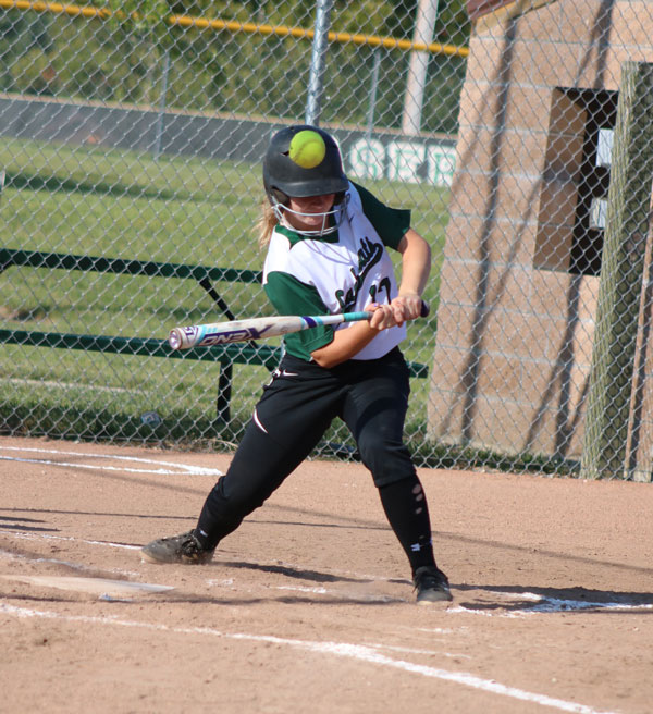 Freshman Kylee Fajen bats against Eldon. The girls took home the win with a 11-1 score.