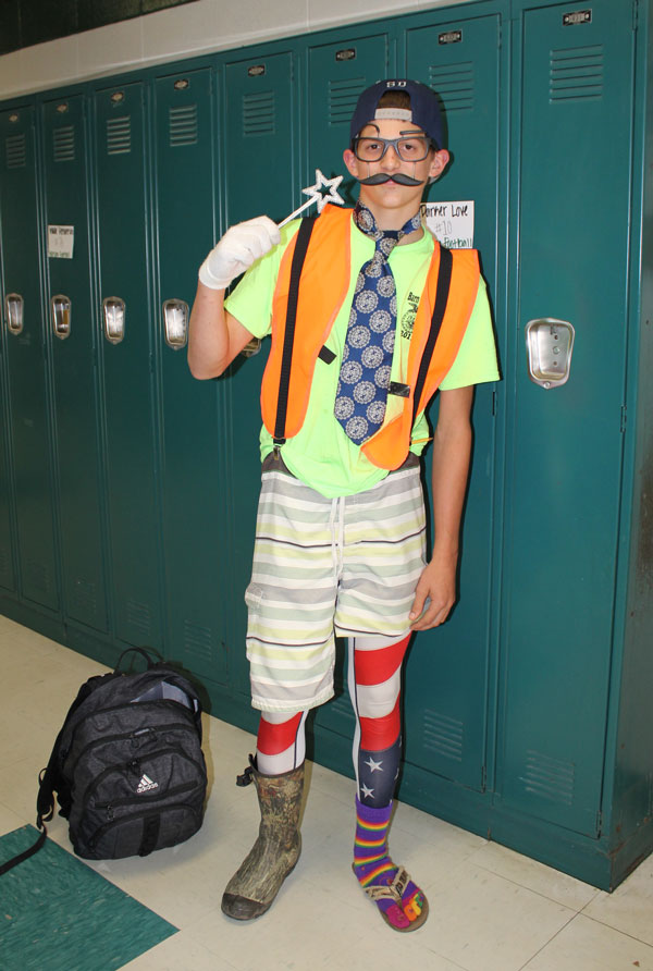 Sophomore Lerran Yoder gets ready to leave for the day in his mismatched attire after celebrating Tornado Tuesday. Students are celebrating Homecoming all week with a spirit week.