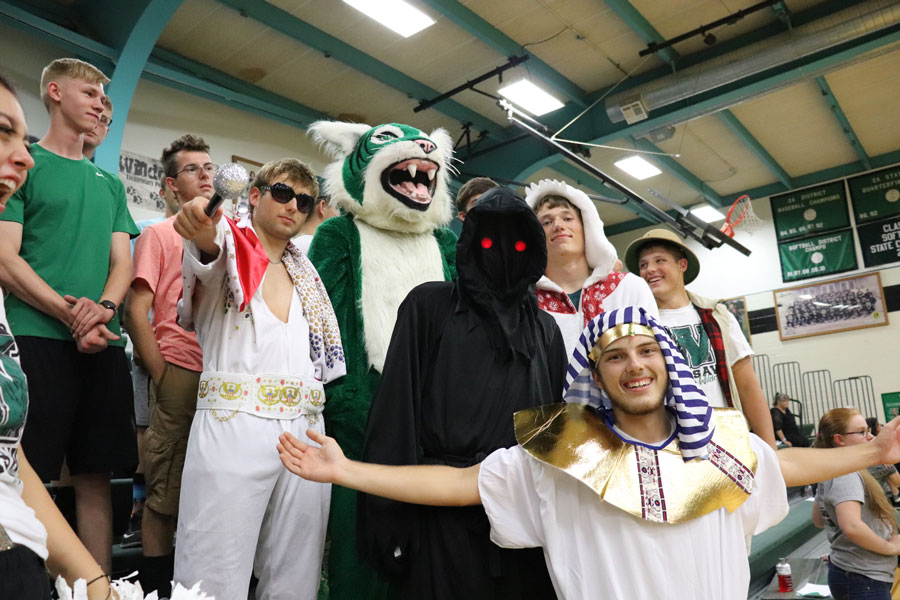 Pep club members, seniors Keegan Glenn, Cash Miller (Wally the Wildcat), Ryan Sprouse, juniors Matt Luebbert and Jacob Luebbert, and senior Ryan Franklin, start the volleyball season off by showing up in different costumes to cheer on the Ladycats.  Costumes for volleyball games ranged anywhere from a pharaoh to a clown.