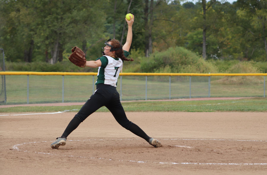 Sophomore+pitching+Payge+Adiar+hurls+the+ball+during+a+recent+game.+Missouri+state+rules+now+require+all+pitchers+to+wear+face+masks.+