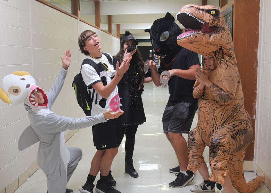 Senior Dallas Larsen, junior Logan Davis, Kamaryn Yach, Jake Luebbert and Rylee Pals get into character on the animal-themed Toto Thursday. Homecoming spirit week had many students getting into costumes to show their Wildcat pride.