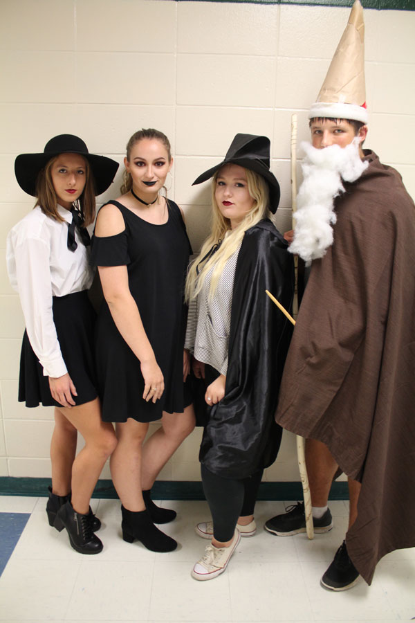 Juniors Abby Foster, Maddie  Gardner, Taylor Bunch and Jake Luebbert get in Homecoming spirit on Witch/Wizard Wednesday.