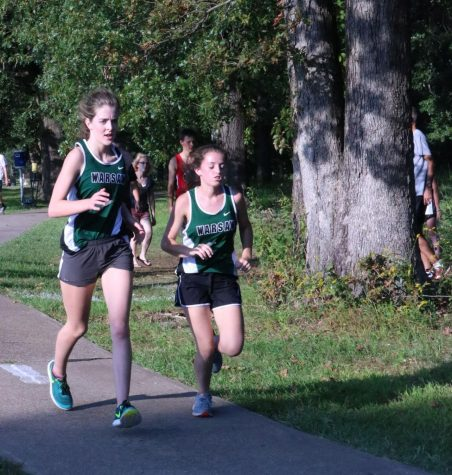 Senior Hannah Chapman, and junior Autumn Long compete at Stockton. Chapman and Long run together to push each other to do better, and work harder to beat their own scores.