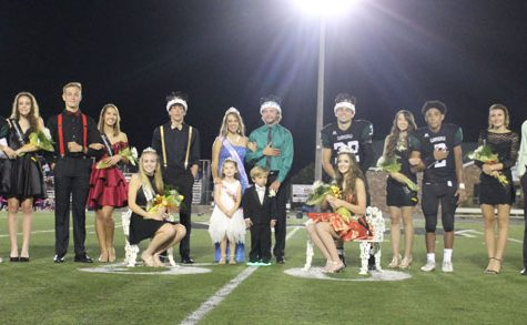 Homecoming royalty and candidates sits and stands after royalty was crowned. Homecoming royalty was crowned at halftime of the football game on Sept. 29.