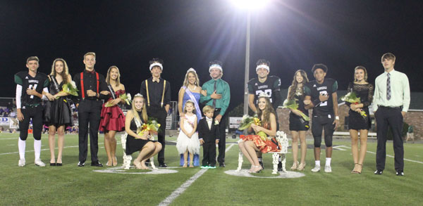 Homecoming+royalty+and+candidates+sits+and+stands+after+royalty+was+crowned.+Homecoming+royalty+was+crowned+at+halftime+of+the+football+game+on+Sept.+29.+