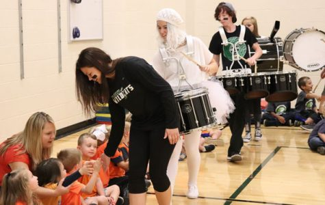 Senior drum major Zoe Eledge and the drum line goes through and high fives the children. All the organizations went through and high fives the children at the beginning and the end of the assembly.