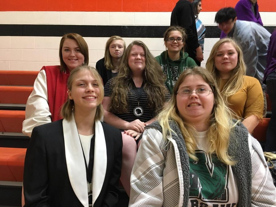 Speech club members (back  row left to right)  sophomores Samantha Townley and Aubri Umlauf, seniors Madison Rozzel and Caitlin Easter, junior Ren Rozzel, freshman Lacey Andrews and junior Electa Good wait to perform their pieces during the Knob Noster speech competition.