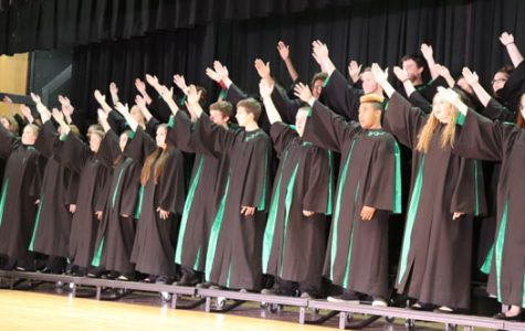The concert choir singing and dancing to one of the group songs. One of the groups songs was dream on.