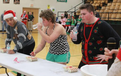 Juniors Keion Davis, Connor McLaughlin, and Mikey Wetro participate in the prince candidate game. The game was to eat the the whole box of cookies first. Keion Davis was the winner of the prince game.