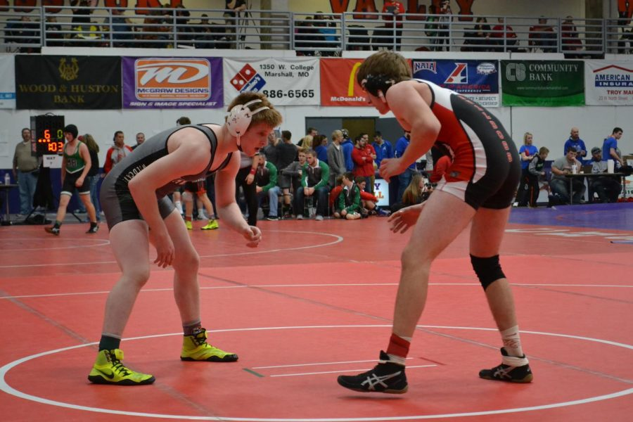 Junior Kolby Estes looks for a shot at his opponent. Estes is currently ranked 1st in the 145 weight class.
