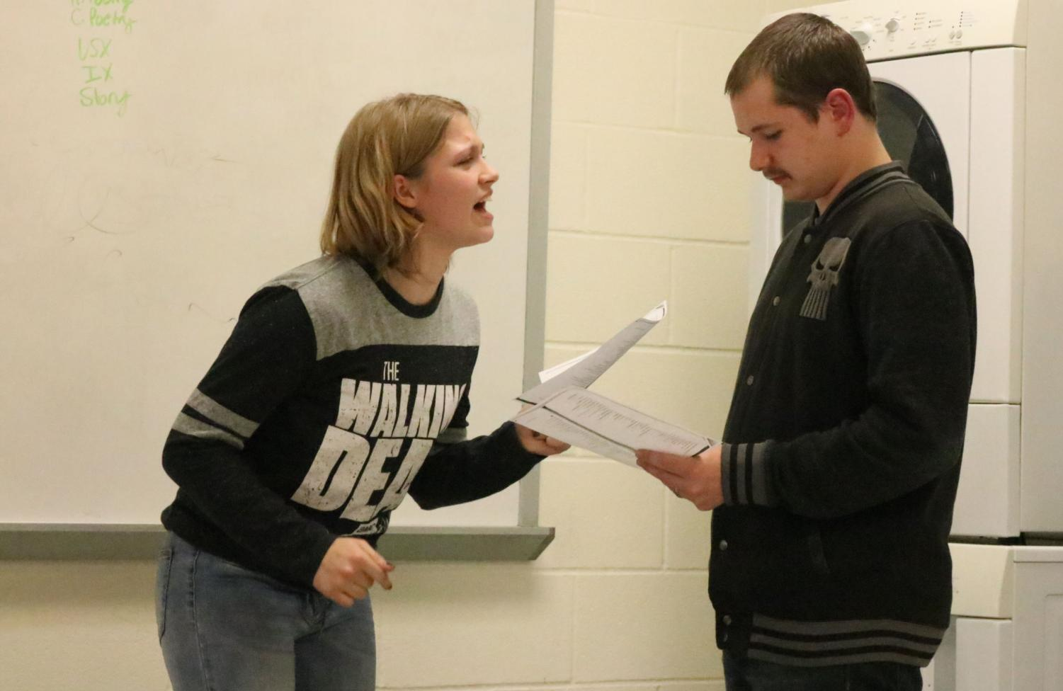 Freshman Lacey Andrews and sophomore Tristan Good practice there skit they had been working on at speech team practice. They preformed this act for there fellow members of speech team.
