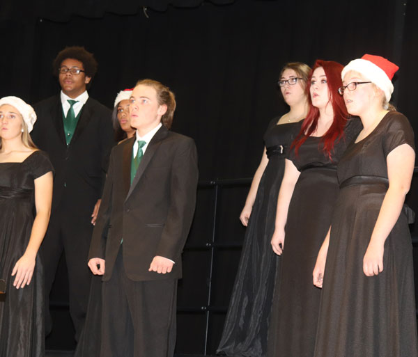 Sophomore Aubrie McRoberts, senior Nate Fauquier, sophomore Aiyana Chenault, juniors Chance Thirstrup, Allison Thomas and sophomores Alyssa Gemes and Jessica Dwyer sing in the winter concert. The winter concert featured concert band, jazz band and all choirs.
